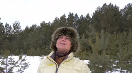 dech : Woman breath with fresh cold winter air in coniferous forest. Adult woman in winter forest.