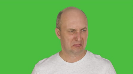 tenso : Middle aged man feeling disgust. Alpha channel, keyed green screen.