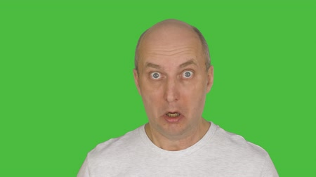 tenso : Middle aged man feeling fear. Alpha channel, keyed green screen.