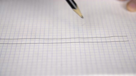 kartka papieru : Drawing five lines in notepad with pencil for music notes