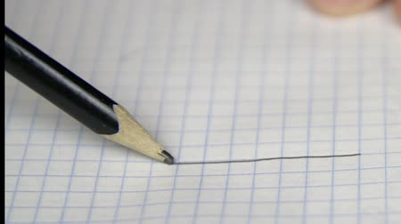 písanka : Drawing one line on copybook page with pencil Dostupné videozáznamy