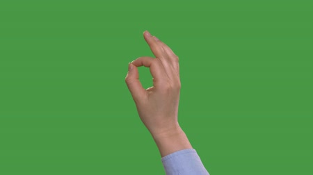 okey : Partial view of woman showing ok sign, keyed green screen
