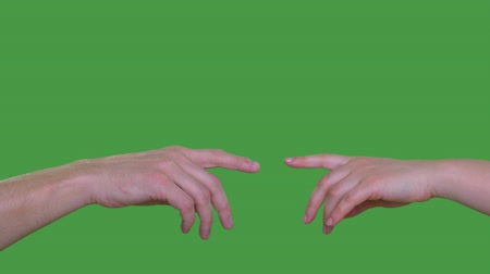 tenso : Two people hands touching with index fingers isolated on green background Alpha channel, keyed green screen