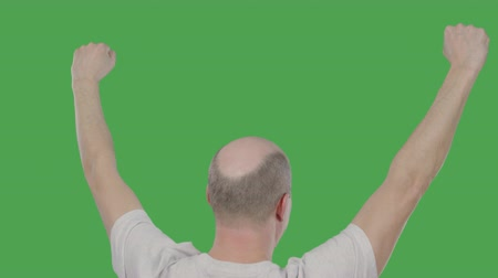 tenso : Man football fan raising hands up for celebrating goal while soccer match on green background. Success concept. Alpha channel, keyed green screen