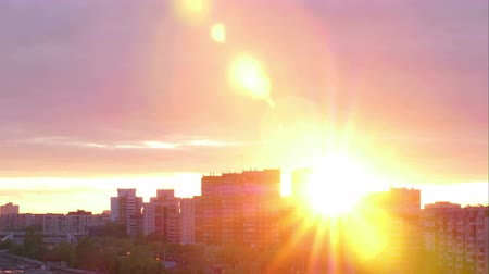város : Beautiful sunset on background multi storey building in city time lapse