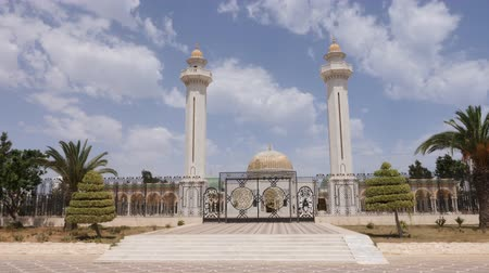 tunisia : Gate at entrance to mausoleum Habib Bourguiba with golden dome in Monastir city. Outdoors dolly shot