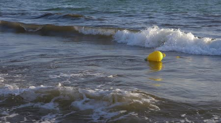 buoy : Yellow buoy floating in sea water slow motion. Sea buoy floating on water waves.