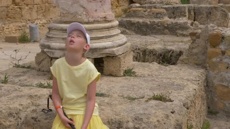 мемориал : Tired teenager girl on tourist excursion while travel on Carthage in Tunisia