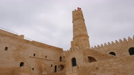 tunisia : High tower and national flag on top of fortress Ribat in Monastir, Tunisia