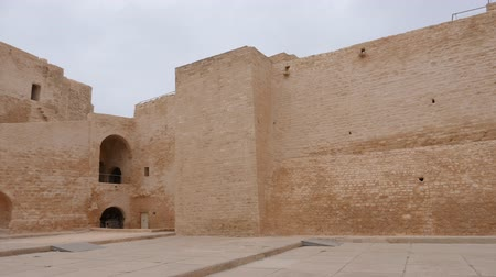 bulutlu : Panning view of brick walls of ancient fortress Ribat in Monastir, Tunisia Stok Video
