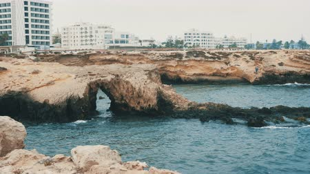 tunisia : Seashore with rocks and coastline with buildings in Monastir city Stock Footage