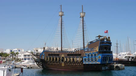 tunisia : Monastir, Tunisia - 08 June 2018: beautiful pirate ship standing in sea port on city landscape background. Sea ship in ancient style in parking lot.
