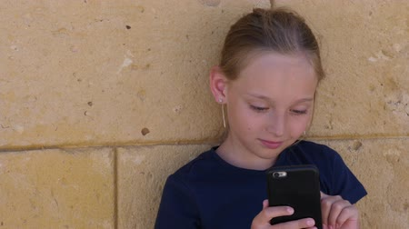 communion : Girl teenager using mobile phone for communication with friend in social network