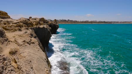 tunisia : Scenic view sea waves on stony cliff on background Monastir city, Tunisia