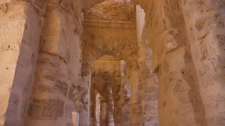 tunisia : Gallery with arches and brick columns in Amphitheatre of El Jem, tilting view Stock Footage