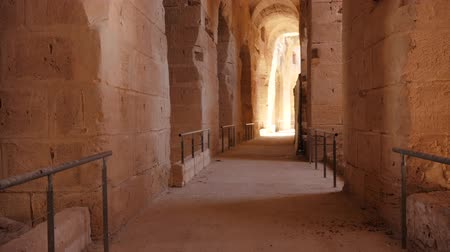 amphitheatre : Move along the corridor with arches and light in fortress. Track shot