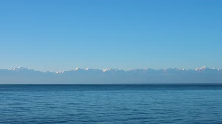 kul : Blue water in lake Issyk Kul on background high mountains