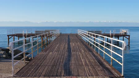 kul : Beautiful background with empty pier on Issyk-Kul lake Stock Footage