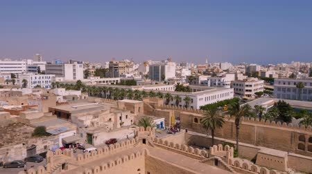 kombináció : Sousse, Tunisia - June 15, 2018. Panoramic view modern Sousse city,Tunisia. Stone fortress and buildings in city