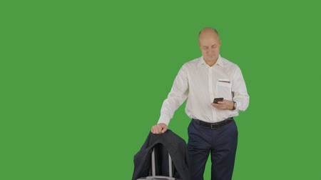 bilet : Business man watch time and check boarding pass with ticket in departure lounge