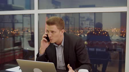 unsuccessful : Angry businessman talking on phone in office. Furious man talking on cell phone Stock Footage