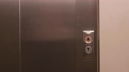winda : Business man pushing button for calling elevator in modern business office. Business manager coming into elevator in modern apartment corridor