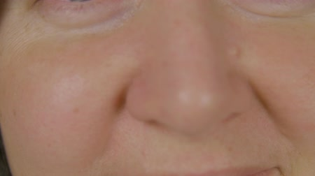 szag : Female face and nose close up. Front view female nose, macro shooting. Respiratory and otolaryngology. Facial surgery and plastic cosmetology