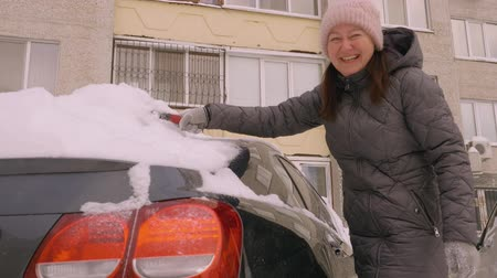 scrape : Woman cleaning snow from car windshield, Scraping ice, Winter car window cleaning. Cleaning concept. Winter snow season. Snow covered car. Winter snow season. Car maintenance beauty. Cold weather.