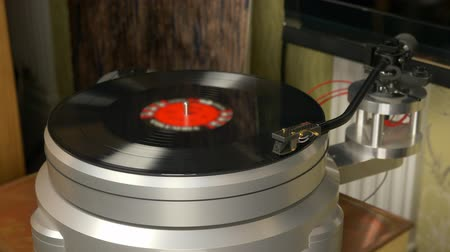 gramophone : Modern turntable aluminium chassie with tonearm and vinil records rotation. Start playing. Gramophone playing vinyl records. Vinyl rotating on retro turntable. Vinyl record turning on music player.