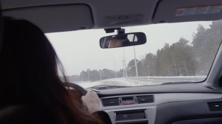 arka görünüm : Woman driving a car on a highway. Adult woman attentivly driving a car. Car trip concept POV Stok Video