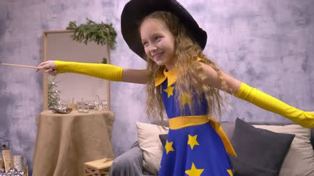 fancier : Stargazer girl dancing. Cute little girl in beautiful wizard dress with stars dancing holding magic stick.