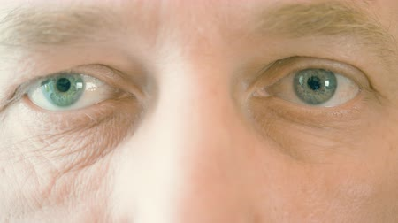 astigmatism : Face and eyes of elderly man winking and looking to camera. Close up male eyes. Ophthalmology and healthy vision. Health care. Parts of face and body. Anatomy human face