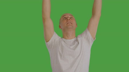 tenso : Adult caucasian man rise up virtual banner or panel or poster by hands at keyed greenscreen transparent background. With alpha channel. Advertising concept