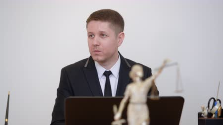 prosecutor : Portrait man lawyer talking on themis statue in law office. Professional lawyer working in business office. Legal consultation concept