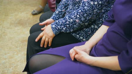 колено : Female knee of woman sitting on seat on conference hall close up. Woman touching knee sitting on chair. Legs adult woman sitting on chairs