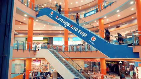 エスカレーター : Moscow, Russia - March 21, 2019: people on escalators, travolators and elevators in modern shopping mall in modern city. Indoor interior modern shopping center 動画素材