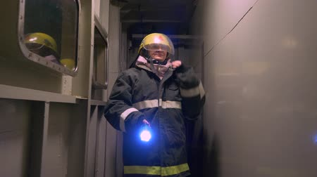 protective suit : Women Rescuer Group Go Tunnel Hold Torch Teamwork. Protection Workers Team Wear Protective Suit Firefighter Helmet First Aid Emergency Situation Safety Service Profession Concept 4K