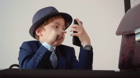 имитация : Kid Businessman Browse Mobile Phone Role Play. Little Caucasian Child Wear Classical Style Suit Hold big Smartphone. Funny Boy Act Boss Office Background Adult Life Imitation Job Game Concept 4K