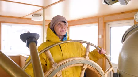 lever : Elderly Woman Turn Steer Wheel Navigation Control. Caucasian Sailor Sea Vessel Wheelhouse Equipment Captain Cabin Background. Nautical Instrument Marine Job Strategy Nautics Concept 4K