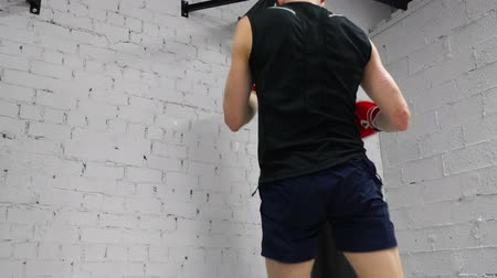 boksör : Boxer Fighter Sport Workout Punch Bag Exercise. Young Caucasian Sportsman Indoor Gym Train Limber up Practice. Healthy Lifestyle Strategy Physical Activity Competition Concept 4K Stok Video