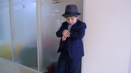 rád : Cute Kid Businessman Look Watch Office Role Play. Caucasian Child Boy Act Professional Boss Wear Traditional Classical Suit. Work Place Hat Head Adult Life Imitation Job Game Concept 4K