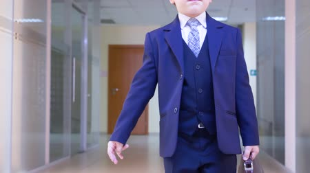 classical suit : Child Businessman Go Office Corridor Role Play. Serious Caucasian Boy Carry Business Bag Work Place Background. Hat Head Traditional Classic Suit Adult Lifestyle Imitation Concept