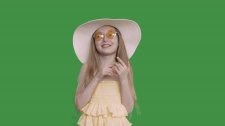 tenso : Happy young white caucasian girl with long hair yelow dress and summer hat laughing into camera. Blonde girl in glasses happy laugh and smile. Isolated transparent background alpha channel