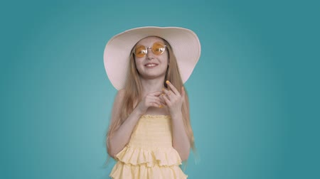 yelow : Happy young white caucasian girl with long hair yelow dress and summer hat laughing into camera. Blonde girl in glasses happy laugh and smile Stock Footage