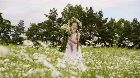 kamilla : Girl Flowers Outdoor Blossom Daisy Meadow Scenery. Happy Attractive Caucasian Female Child in Floral Wreath Pose Picture. Cute Kid Enjoy Nature Hold Wildflowers Bouquet Leisure Concept