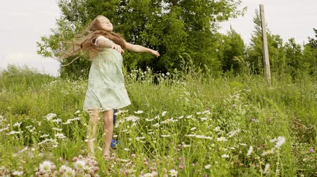 kayran : Summer vacation on countryside, village, farm. Happy childhood and outdoor activities. Teens children boy and girl playing on meadow together at summer on vacation. Cute children in nature park.