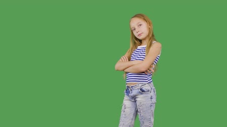 tenso : Young girl model posing front camera on green background. Girl teenager smiling and looking to camera on photo session on chromakey screen. Alpha channel, keyed green screen Vídeos