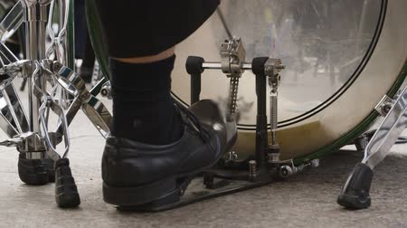 treadle : Close up male drummer feet playing music on bass drum pedal. Man playing music on percussion instrument. Musical performance outdoor