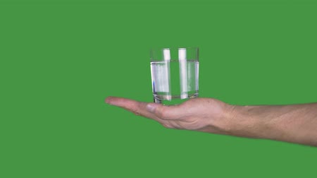 senza volto : Hand holding glass of water. Close-up partial view of person holding glass full of fresh clear water on Alpha Channel background.