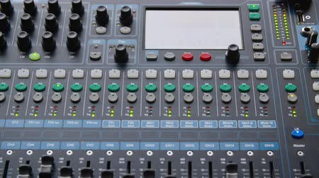 ladění : Sound mixer console. Close-up view of modern electrical sound mixer console during concert or rehearsal in sound recording studio, full frame view. Music concept